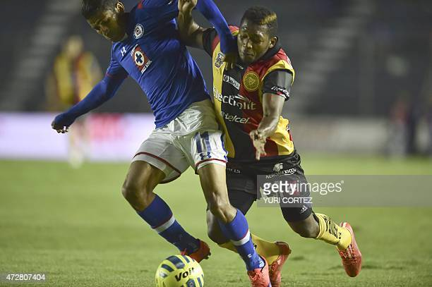 Leones Negros's forward Jonathan Gonzalez vies for the ball with Cruz Azul's midfielder Joao Rojas during their Clausura tournament football match at...