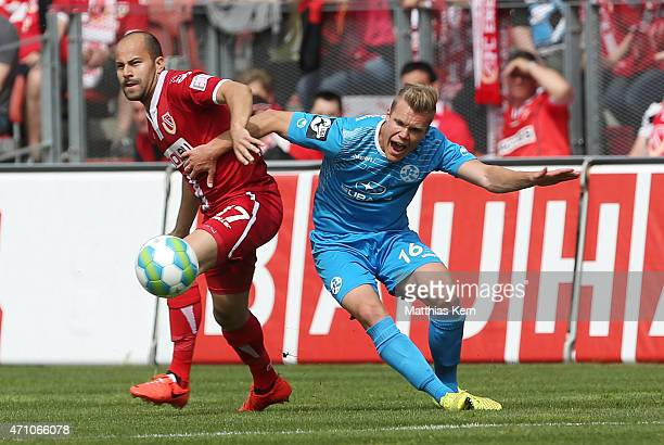Leonhard Kaufmann of Cottbus battles for the ball with Fabio Leutenecker of Stuttgart during the third league match between FC Energie Cottbus and SV...