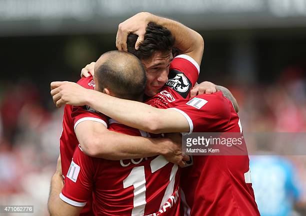 Leonhard Kaufmann of Cottbus jubilates with team mates after scoring the first goal during the third league match between FC Energie Cottbus and SV...