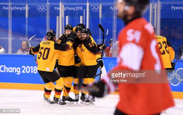 Leonhard Pfoderl of Germany celebrates with teammates after scoring a goal in the first period against Switzerland during the Men's Ice Hockey...