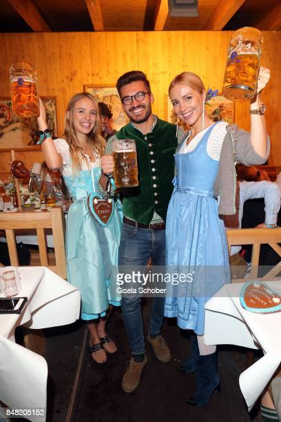 Leonia Hanne, Justus Hansen and Viktoria Rader during the 'Fruehstueck bei Tiffany' at Schuetzenfesthalle at the Oktoberfest on September 16, 2017 in...