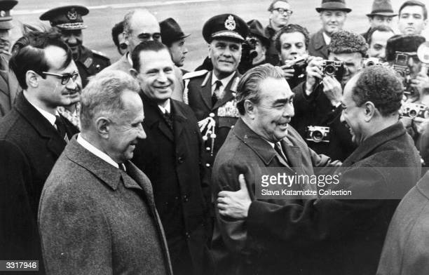 Leonid Ilyich Brezhnev general secretary of the Soviet Communist Party greets the new Egyptian president Anwar alSadat who is in Moscow to ask for...