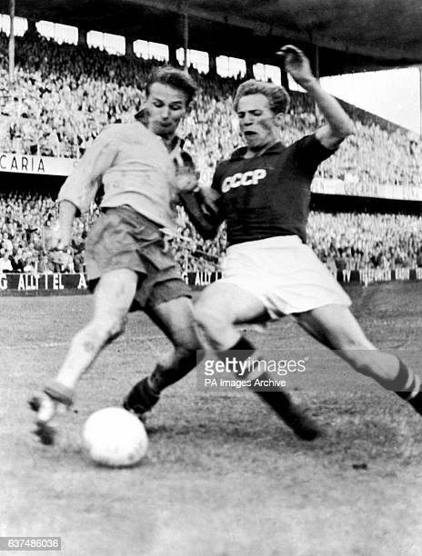 Leonid Ivanov the Soviet goalkeeper takes the ball from Nils Rikeberg the Finnish centre forward