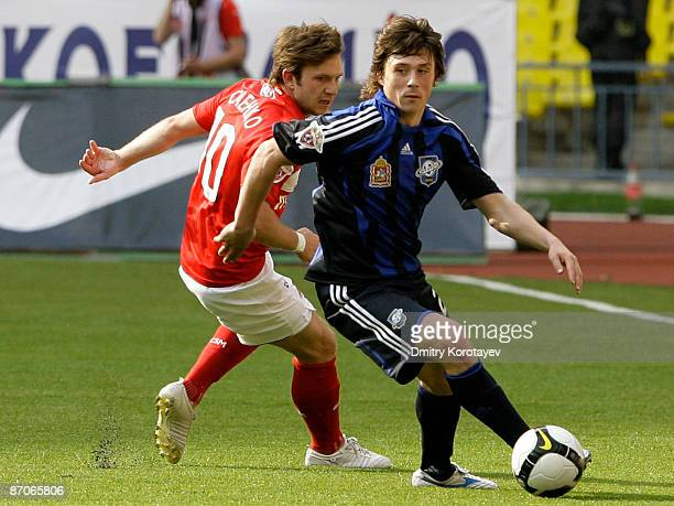 Leonid Kovel of Saturn Moscow Oblast in action against Ivan Saenko of Spartak Moscow during the Russian Premier League match between FC Spartak...