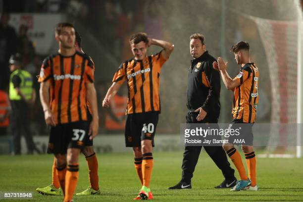 Leonid Slutsky head coach / manager of Hull City and dejected Hull City players at full time during the Carabao Cup Second Round match between...