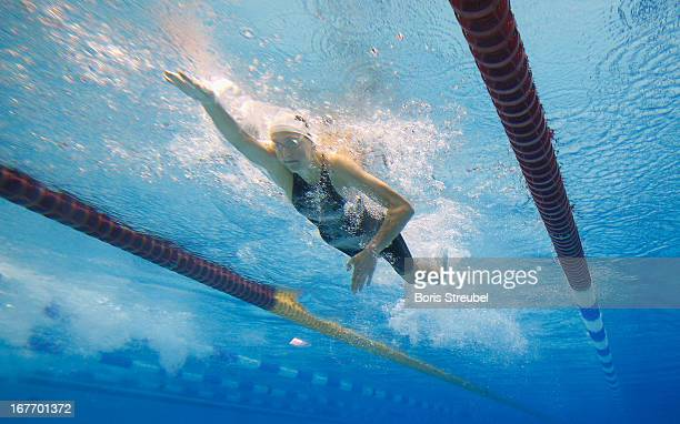 Leonie Antonia Beck of SV Wuerzburg 05 competes in the women's 200 m freestyle heat during day three of the German Swimming Championship 2013 at the...