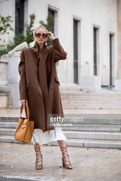 Leonie Hanne attends the Tod's Lunch Outside arrivals at Monsieur Bleu as part of the Paris Fashion Week Womenswear Fall/Winter 2019/2020 on March 05...