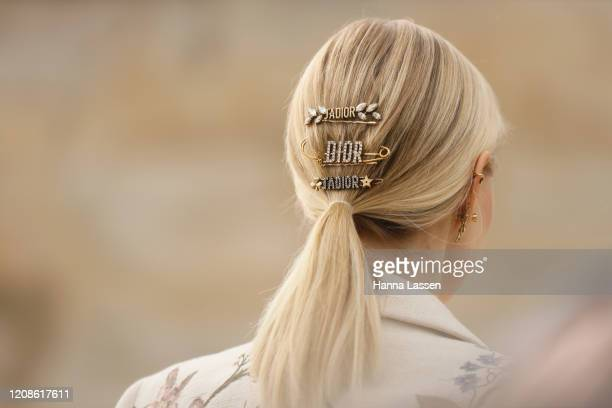 Leonie Hanne hair pin detail wearing Dior jacket Dior belt and Dior bag outside the Dior show as part of the Paris Fashion Week Womenswear...