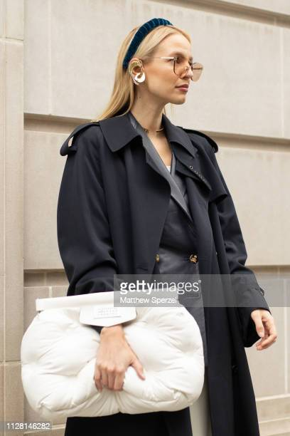 Leonie Hanne is seen on the street during New York Fashion Week AW19 wearing black trench coat grey blazer white hand bag and gold earring with...