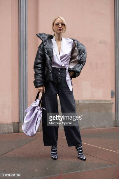 Leonie Hanne is seen on the street during New York Fashion Week AW19 wearing silver top with black down coat and silver bag on February 08 2019 in...