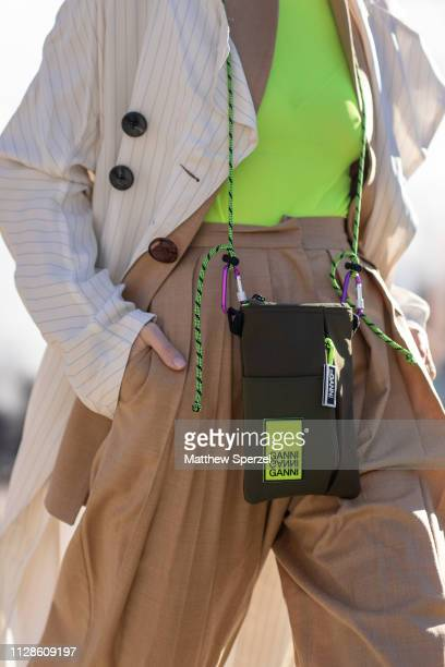 Leonie Hanne is seen on the street during New York Fashion Week AW19 wearing Self Portrait outfit with neon top and Ganni bag on February 09 2019 in...