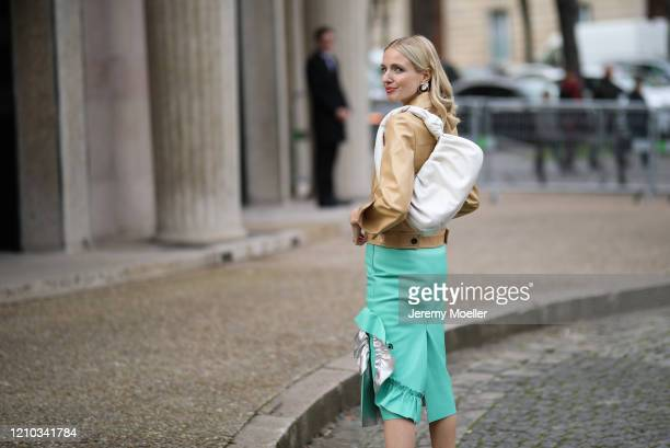 Leonie Hanne is seen outside the Miu Miu show during Paris Fashion week Womenswear Fall/Winter 2020/2021 Day Eight on March 02, 2020 in Paris, France.