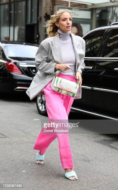 Leonie Hanne is seen wearing a Fendi bag, grey blazer and pink pants outside of the Ulla Johnson show on February 08, 2020 in New York City.