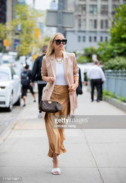 Leonie Hanne is seen wearing asymmetric silk skirt, pastel blazer outside Sally LaPointe during New York Fashion Week September 2019 on September 10,...