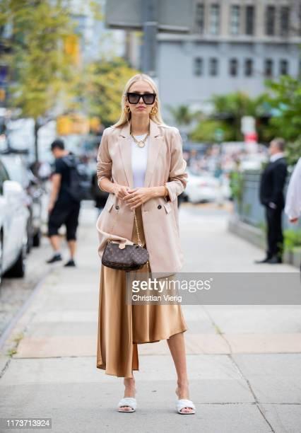 Leonie Hanne is seen wearing asymmetric silk skirt, pastel blazer outside Sally LaPointe during New York Fashion Week September 2019 on September 10,...