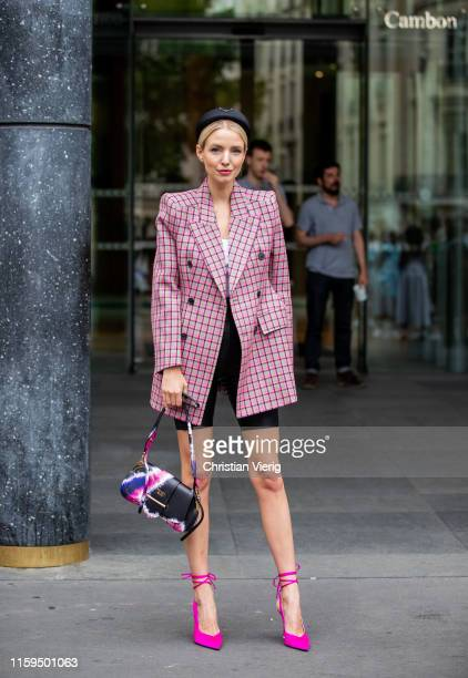 Leonie Hanne is seen wearing batik Prada bag yellow plaid blazer hair loop cycle pants pink heels outside Schiaparelli during Paris Fashion Week...
