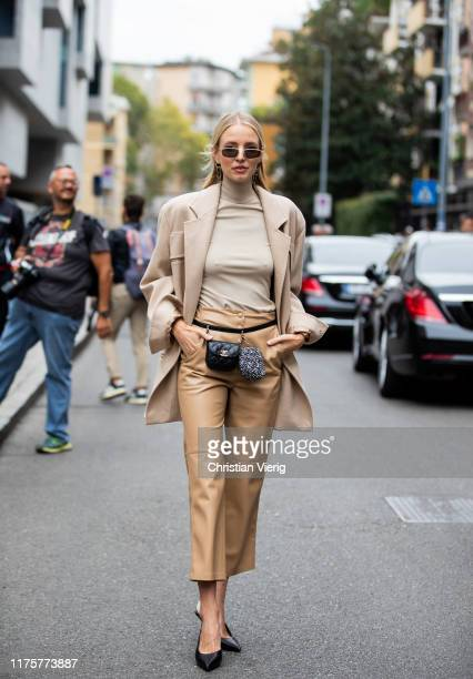 Leonie Hanne is seen wearing beige grey turtleneck, jacket, pants, black Chanel mini belt bag outside the Max Mara show during Milan Fashion Week...