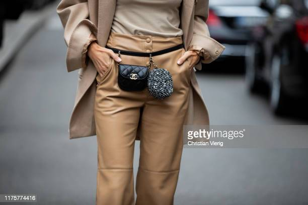 Leonie Hanne is seen wearing beige grey turtleneck jacket pants black Chanel mini belt bag outside the Max Mara show during Milan Fashion Week...