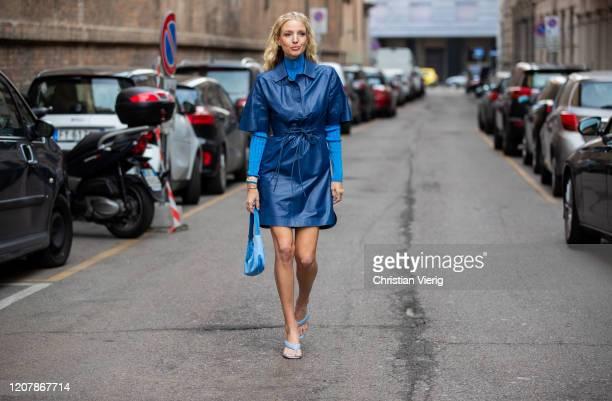 Leonie Hanne is seen wearing blue turtleneck, blue dress, Prada bag outside Sportmax during Milan Fashion Week Fall/Winter 2020-2021 on February 21,...