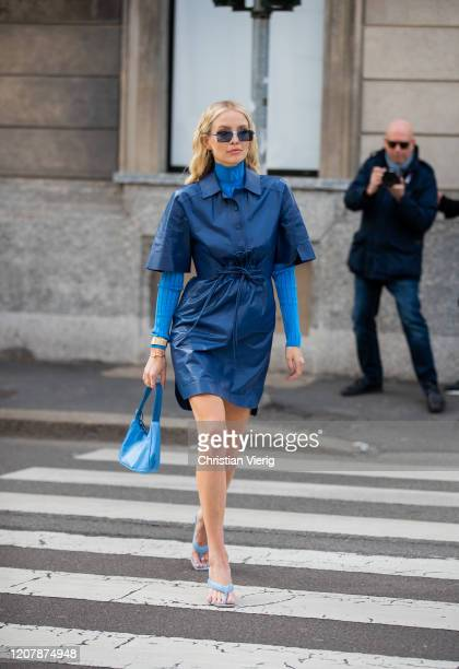 Leonie Hanne is seen wearing blue turtleneck blue dress Prada bag outside Sportmax during Milan Fashion Week Fall/Winter 20202021 on February 21 2020...