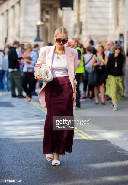 Leonie Hanne is seen wearing bordeaux skirt, pink blazer outside Roland Mouret during London Fashion Week September 2019 on September 15, 2019 in...