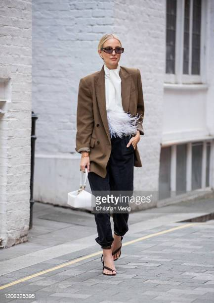 Leonie Hanne is seen wearing brown blazer white blouse black pants sandals white bag outside 16Arlington during London Fashion Week February 2020 on...
