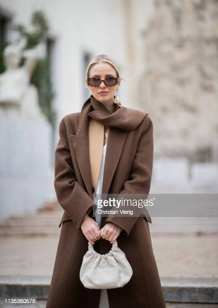 Leonie Hanne is seen wearing brown coat bag dress outside Tods lunch during Paris Fashion Week Womenswear Fall/Winter 2019/2020 on March 05 2019 in...