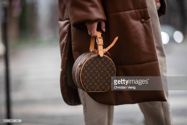 Leonie Hanne is seen wearing brown coat round Louis Vuitton bag outside Alexandre Vauthier during Haute Couture Spring Summer 2019 Day Two on January...