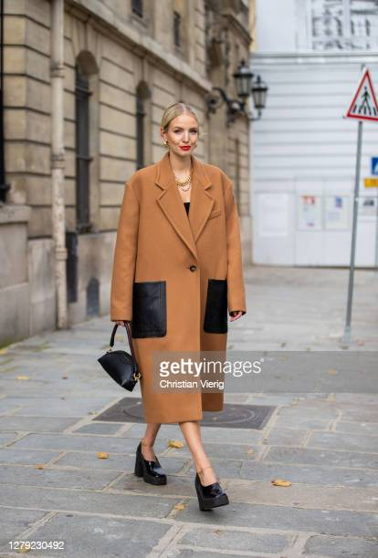 Leonie Hanne is seen wearing brown coat Stella McCartney, black Stella McCartney bag, Stella McCartney shoes during a Street Style Fashion Photo...