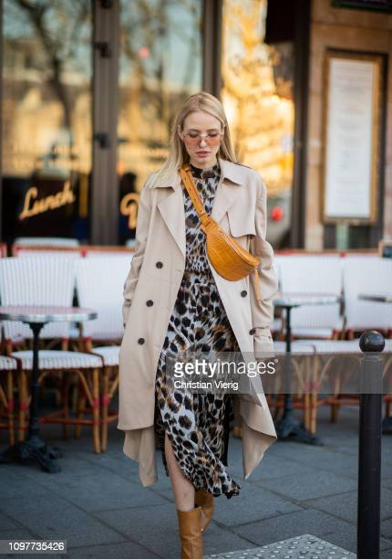 Leonie Hanne is seen wearing fanny bag, trench coat, dress with animal print outside Iris Van Herpen during Paris Fashion Week - Haute Couture Spring...