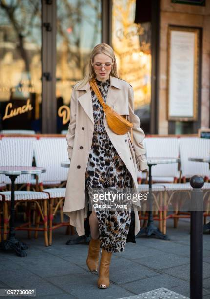 Leonie Hanne is seen wearing fanny bag trench coat dress with animal print outside Iris Van Herpen during Paris Fashion Week Haute Couture Spring...