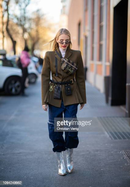 Leonie Hanne is seen wearing Fendi belt bag olive blazer jacket denim jeans silver boots sunglasses outside Fendi during Milan Menswear Fashion Week...