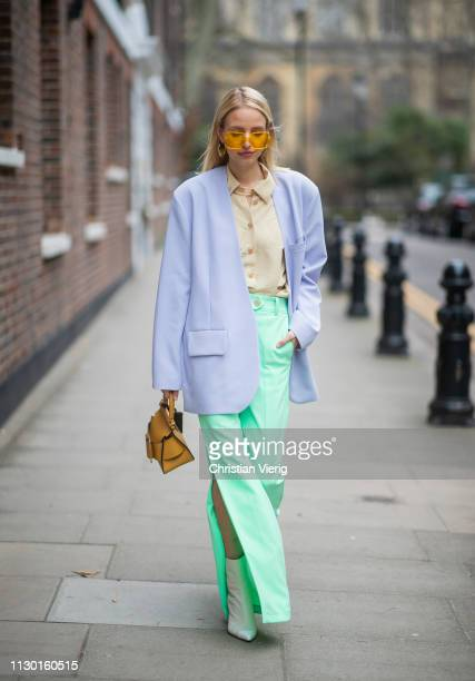 Leonie Hanne is seen wearing green flared pants with slit purple blazer Boyy bag yellow button shirt outside AWAKE Awake during London Fashion Week...