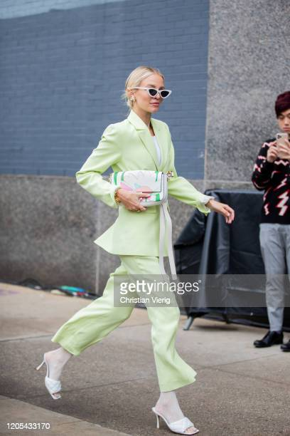Leonie Hanne is seen wearing green suit outside Jonathan Simkhai during New York Fashion Week Fall / Winter on February 10, 2020 in New York City.