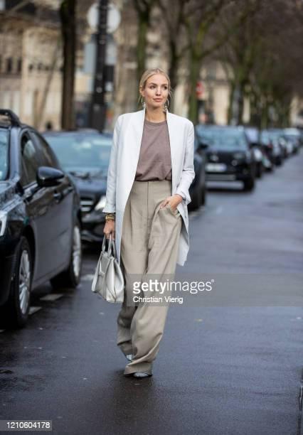 Leonie Hanne is seen wearing grey wide leg pants white coat bag outside Akris during Paris Fashion Week Womenswear Fall/Winter 2020/2021 Day Eight on...