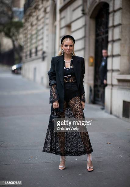 Leonie Hanne is seen wearing hair loop black sheer dress during Paris Fashion Week Womenswear Fall/Winter 2019/2020 on March 01 2019 in Paris France