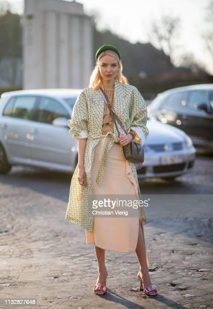 Leonie Hanne is seen wearing hair loop shirt beige skirt blouse outside Rochas during Paris Fashion Week Womenswear Fall/Winter 2019/2020 on February...