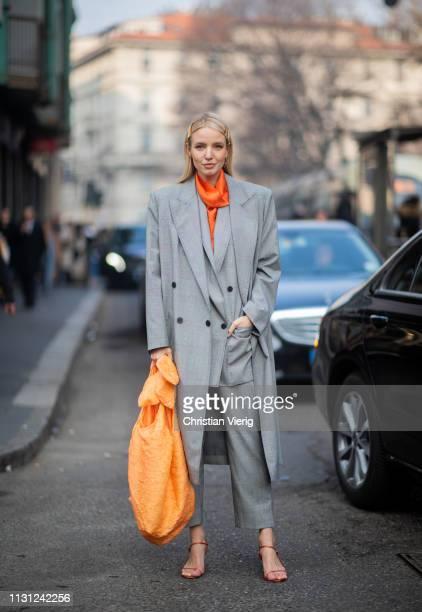 Leonie Hanne is seen wearing heels orange bag grey coat and suit outside Max Mara on Day 2 Milan Fashion Week Autumn/Winter 2019/20 on February 21...