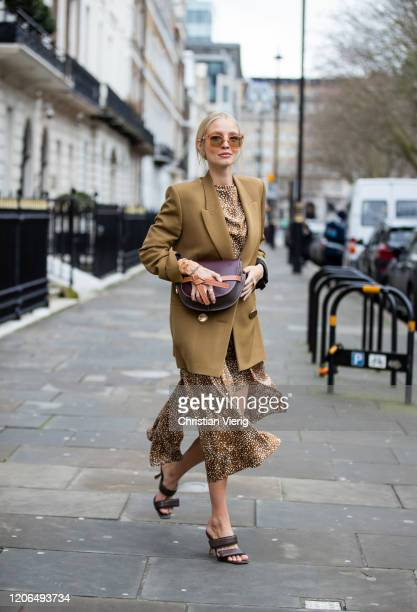 Leonie Hanne is seen wearing olive blazer, asymmetric dress, Loewe bag outside Petar Petrov during London Fashion Week February 2020 on February 15,...