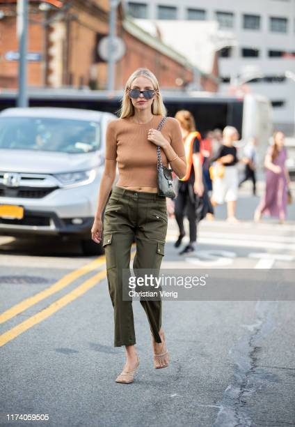 Leonie Hanne is seen wearing olive pants cropped knit outside Michael Kors during New York Fashion Week September 2019 on September 11 2019 in New...