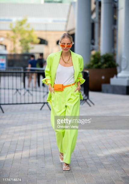 Leonie Hanne is seen wearing orange Jacquemus mini fanny bag neon suit outside House of Holland during London Fashion Week September 2019 on...