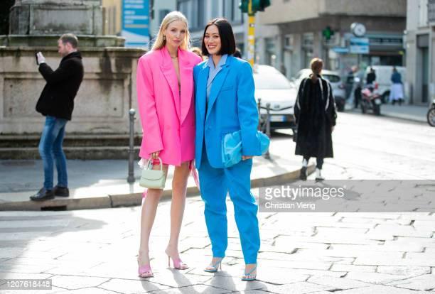 Leonie Hanne is seen wearing oversized pink Vetements blazer, dress, grey mini bag, pink heels and Tiffany Hsu wearing blue suit, outside Pucci...
