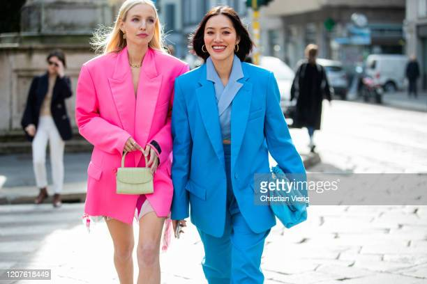 Leonie Hanne is seen wearing oversized pink Vetements blazer, dress, grey mini bag and Tiffany Hsu wearing blue suit, outside Pucci during Milan...