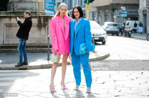 Leonie Hanne is seen wearing oversized pink Vetements blazer, dress, grey mini bag, pink heels and Tiffany Hsu wearing blue suit, bag outside Pucci...