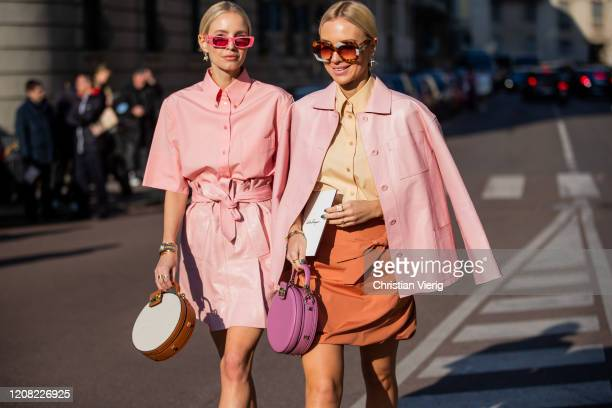 Leonie Hanne is seen wearing pink button shirt and mini skirt, round bag and Viktoria Rader wearing pink jacket, round bag, camel button shirt, skirt...