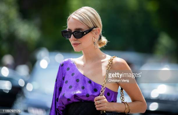 Leonie Hanne is seen wearing purple ripped off shoulder dress, Chanel earrings outside Redemption during Paris Fashion Week - Haute Couture...