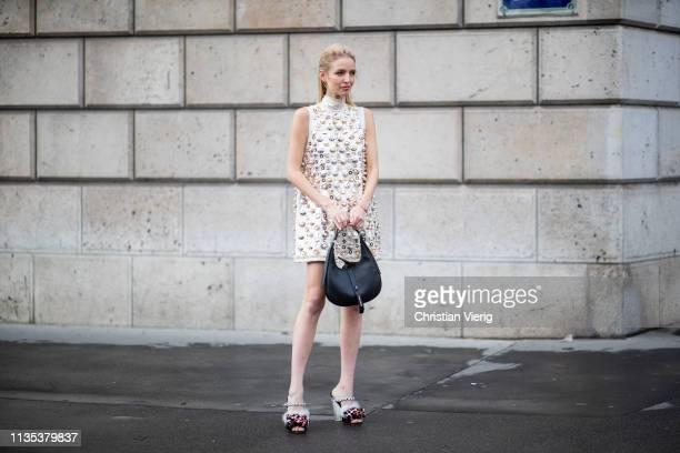 Leonie Hanne is seen wearing sleeveless dress bag heels outside Miu Miu during Paris Fashion Week Womenswear Fall/Winter 2019/2020 on March 05 2019...