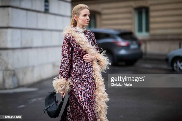 Leonie Hanne is seen wearing sleeveless dress coat bag outside Miu Miu during Paris Fashion Week Womenswear Fall/Winter 2019/2020 on March 05 2019 in...