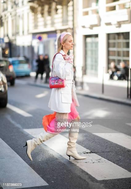 Leonie Hanne is seen wearing white blazer pink Louis Vuitton bag pink hair loop outside Marques Almeida during Paris Fashion Week Womenswear...