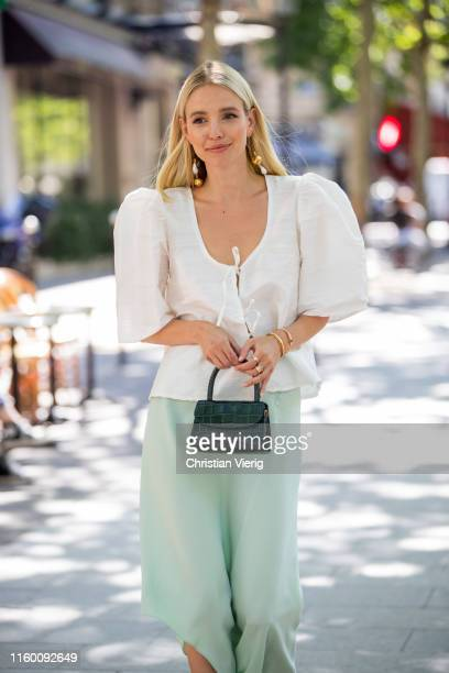 Leonie Hanne is seen wearing white blouse green mini bag asymmetric silk skirt outside Zuhair Murad during Paris Fashion Week Haute Couture...
